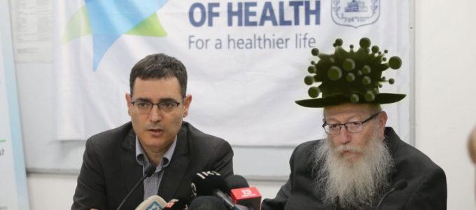 """שר הבריאות יעקב ליצמן בכובע קורונה ומנכ""""ל משרד הבריאות משה בר סימן-טוב"""